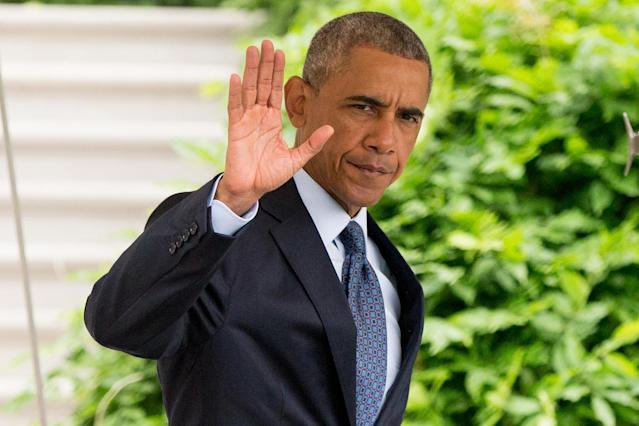 <p>President Obama waves to members of the media as he walks to Marine One on the South Lawn of the White House for the trip to Andrews Air Force Base. (AP/Andrew Harnik) </p>