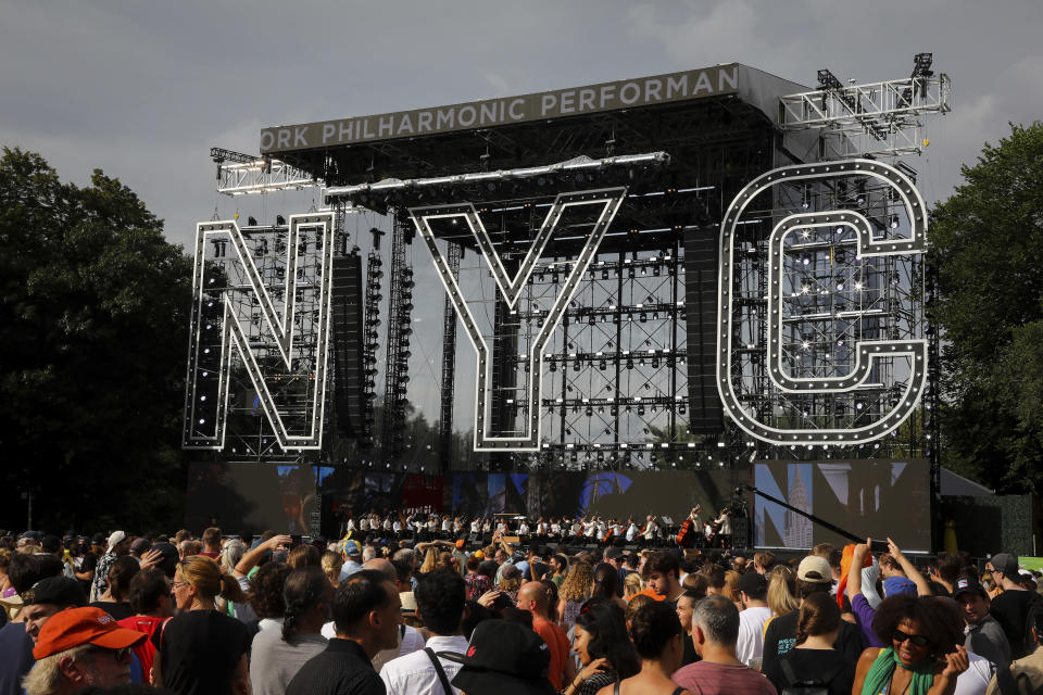 Concertgoers attend We Love NYC: The Homecoming Concert at the Great Lawn in Central Park on Saturday, Aug. 21, 2021, in New York. (Photo by Andy Kropa/Invision/AP)