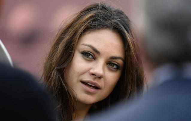 Mila Kunis walks along the sideline before the NFL football game between the Pittsburgh Steelers and the Chicago Bears at Heinz Field on Sunday, Sept. 22, 2013, in Pittsburgh. (AP Photo/Keith Srakocic)