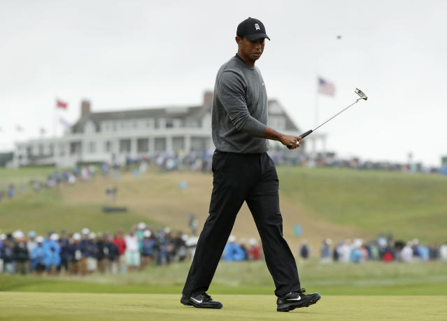 Tiger Woods reacts after missing a putt on the first green during the second round of the U.S. Open Golf Championship, Friday, June 15, 2018, in Southampton, N.Y. (AP Photo/Frank Franklin II)
