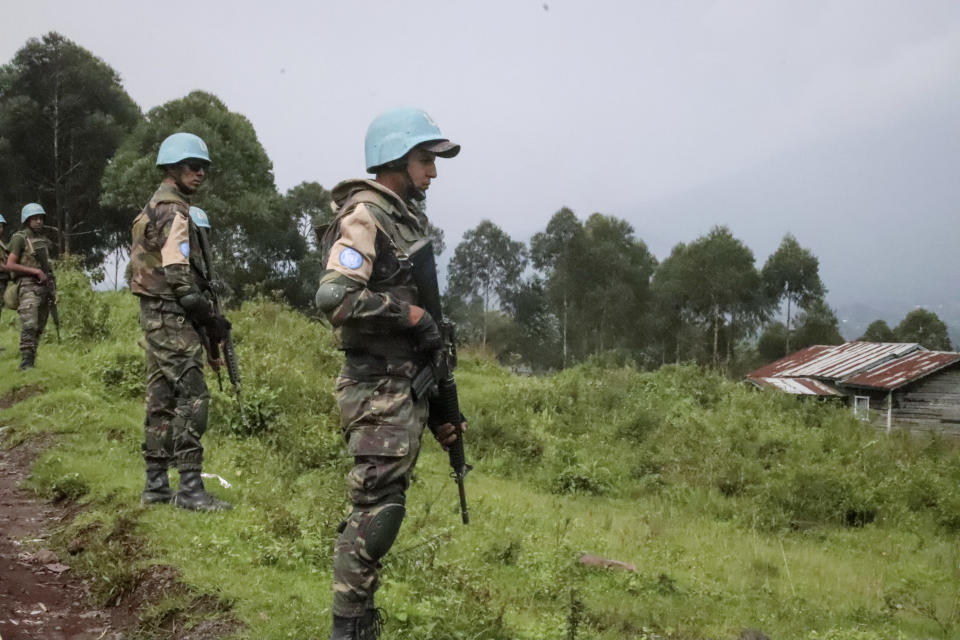 United Nations peacekeepers guard the area where a U.N. convoy was attacked and the Italian ambassador to Congo killed, in Nyiragongo, North Kivu province, Congo Monday, Feb. 22, 2021. The Italian ambassador to Congo Luca Attanasio, an Italian carabineri police officer and their Congolese driver were killed Monday in an attack on a U.N. convoy in an area that is home to myriad rebel groups, the Foreign Ministry and local people said. (AP Photo/Justin Kabumba)