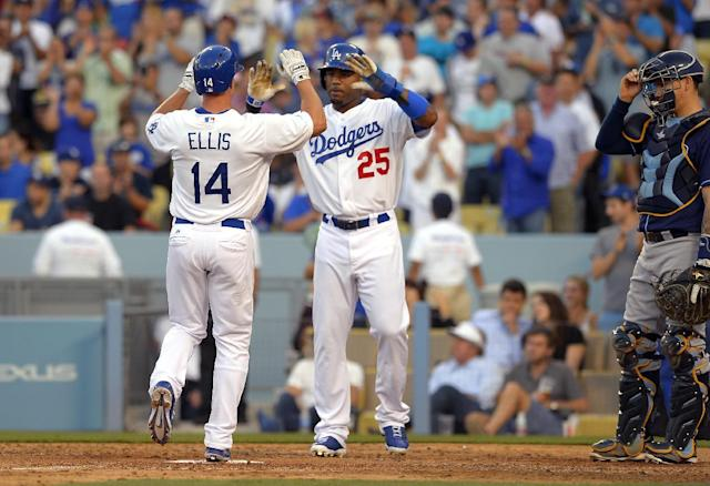 Los Angeles Dodgers' Mark Ellis, left, is congratulated by Carl Crawford after hitting a two-run home run as Tampa Bay Rays catcher Jose Lobaton looks on during the sixth inning of their baseball game, Sunday, Aug. 11, 2013, in Los Angeles. (AP Photo/Mark J. Terrill)