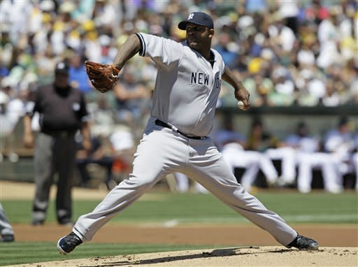 New York Yankees starting pitcher CC Sabathia throws against the Oakland Athletics during the first inning of their baseball game Sunday, July 22, 2012 in Oakland, Calif. (AP Photo/Eric Risberg)
