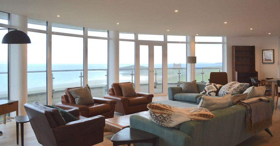 """<p>A circular penthouse with 360-degree views over the beaches and coastal cliffs in Newquay? Where do we sign? With its eight-person hot tub outside, four bedrooms with monsoon showers and Fistral Beach (one of the best in Cornwall, in our book) just a 15-minute walk away, we think this is a must-book, ASAP. </p><p><a class=""""link rapid-noclick-resp"""" href=""""https://www.i-escape.com/pentire-penthouse"""" rel=""""nofollow noopener"""" target=""""_blank"""" data-ylk=""""slk:BOOK HERE"""">BOOK HERE </a></p>"""