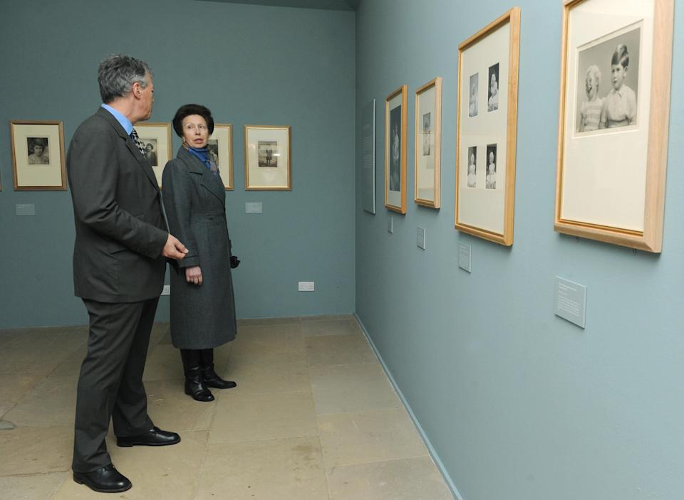 The Princess Royal speaks with David Lascelles, Earl of Harewood, as they view an exhibition of royal photographs taken by royal photographer Marcus Adams on display at Harewood House, Leeds.   (Photo by Anna Gowthorpe/PA Images via Getty Images)