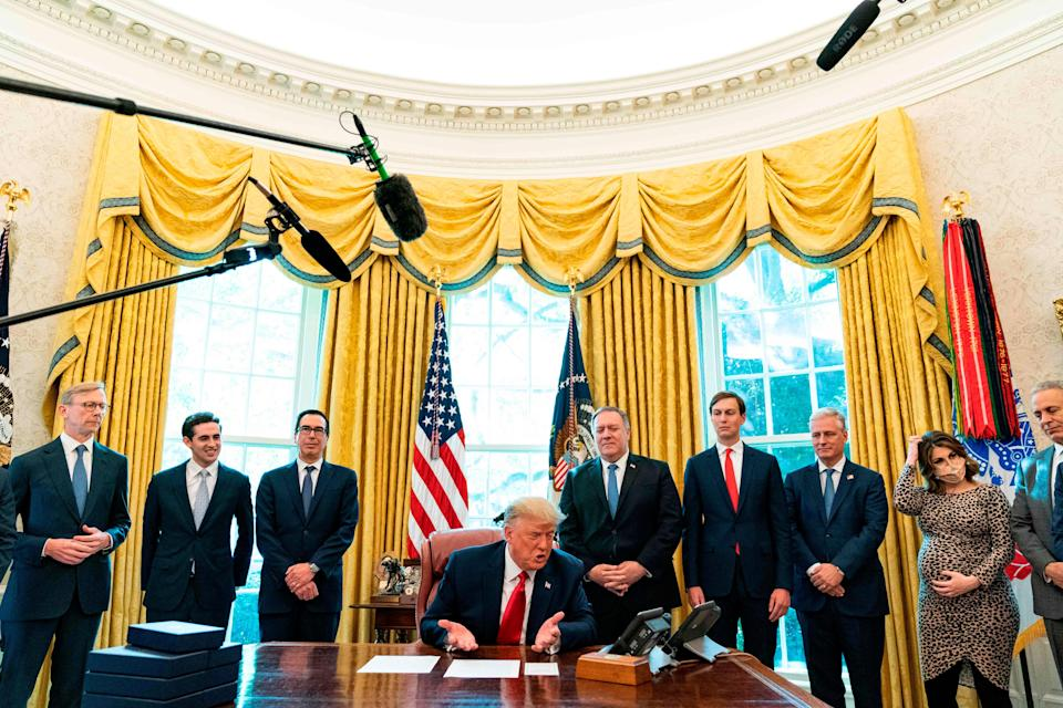 """US President Donald Trump speaks to the leaders of Sudan and Israel as he announces that Sudan will normalize relations with Israel at the White House in Washington, DC, on October 23, 2020. - """"Sudan and Israel have agreed to the normalization of relations -- another major step toward building peace in the Middle East with another nation joining the Abraham Accords,"""" Trump said."""
