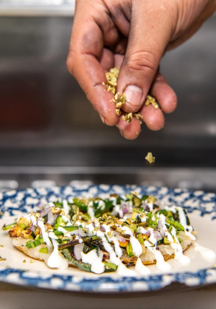 "The popular rajas taco from Masataco features pasilla peppers, squash and pepitas. <span class=""copyright"">(Mariah Tauger / Los Angeles Times)</span>"