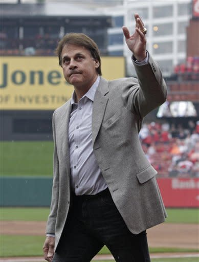 Former St. Louis Cardinals manager Tony La Russa salutes the fans as he before receiving his 2011 World Series championship ring before a baseball game between the St. Louis Cardinals and the Chicago Cubs, Saturday, April 14, 2012 in St. Louis.(AP Photo/Tom Gannam)