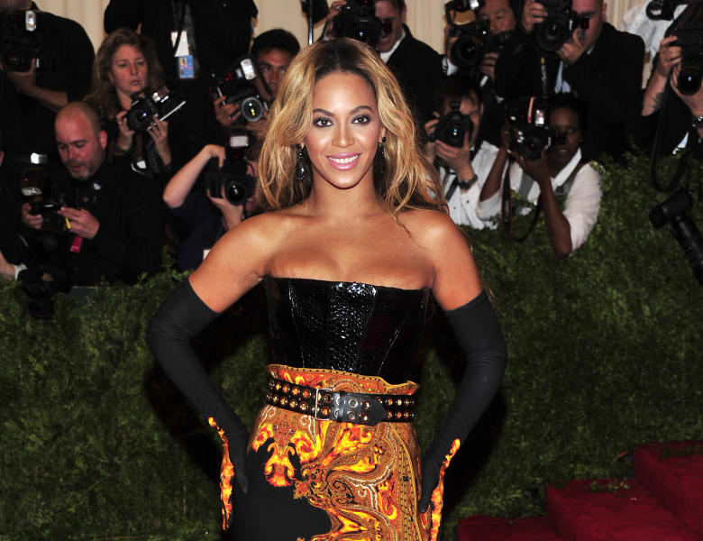 """FILE - This May 6, 2013 file photo shows singer Beyonce at The Metropolitan Museum of Art's Costume Institute benefit in New York. Beyonce has released her new album in an unconventional way: She announced and dropped it on the same day. The singer released """"Beyonce"""" exclusively on iTunes early Friday, Dec. 13. (Photo by Charles Sykes/Invision/AP, File)"""