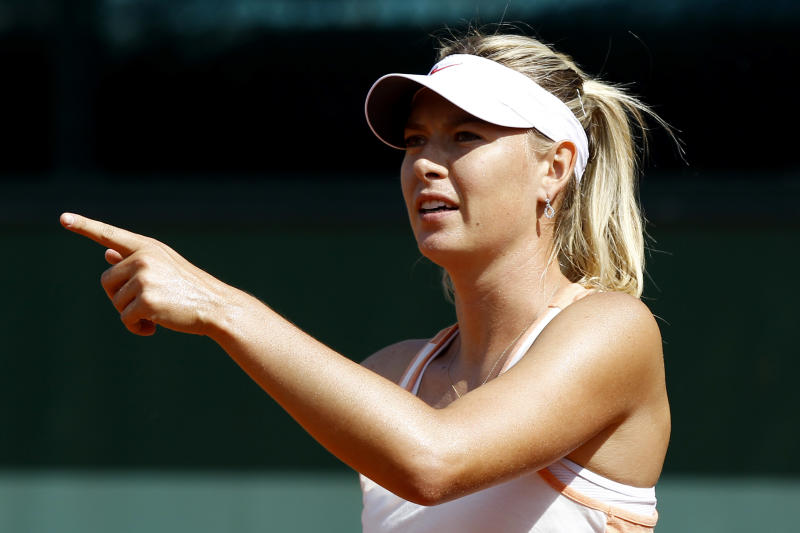 Russia's Maria Sharapova reacts as she trains for the French Open tennis tournament at the Roland Garros stadium in Paris, Sunday, May, 27, 2012. (AP Photo/Christophe Ena)