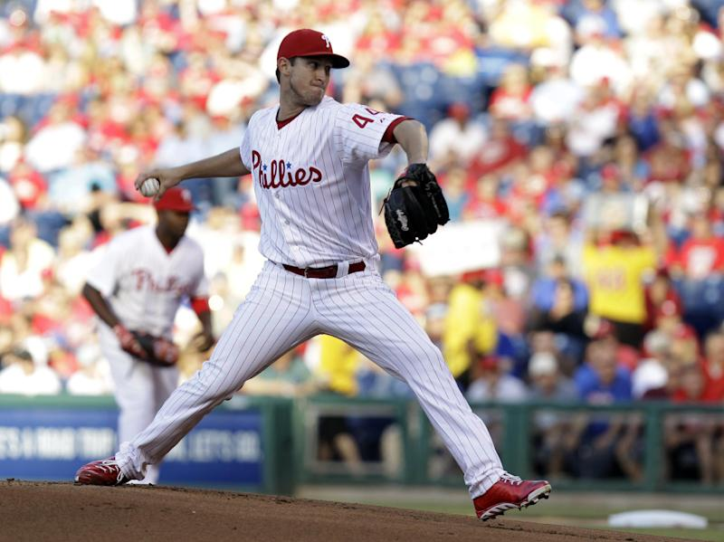Philadelphia Phillies' pitcher Jonathan Pettibone winds up in the first inning of a baseball game against the Miami Marlins, Tuesday, June 4, 2013, in Philadelphia. (AP Photo/Laurence Kesterson)