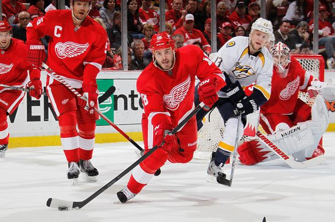Ian White #18 Of The Detroit Red Wings Passes The Puck Up Ice In Front Of Nick Spaling #13 Of The Nashville Predators Getty Images