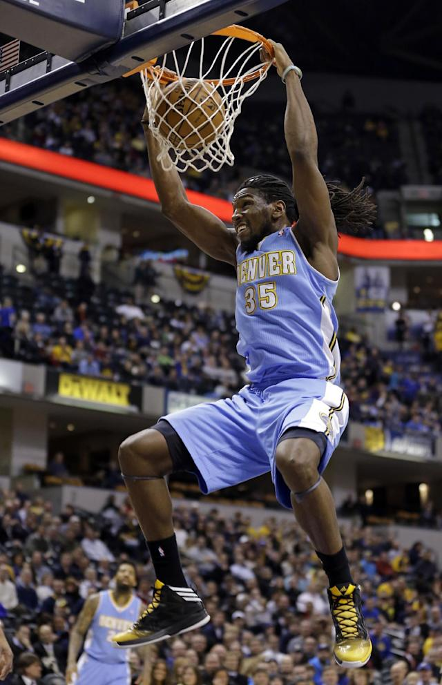 Denver Nuggets forward Kenneth Faried dunks against the Indiana Pacers in the first half of an NBA basketball game in Indianapolis, Monday, Feb. 10, 2014. (AP Photo/Michael Conroy)