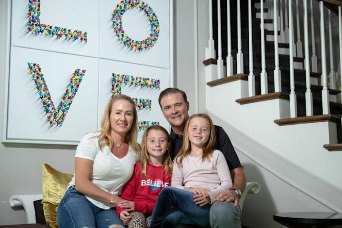 Former Kentucky women's basketball head coach Matthew Mitchell at home this week with his wife, Jenna, and two daughters, Presley and Saylor. Mitchell, 50, says working at home during the coronavirus pandemic caused a family-oriented change in his priorities which led to his surprise resignation as UK head coach before the 2020-21 season.