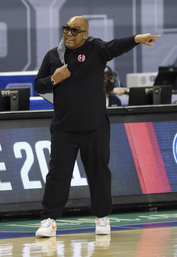 Syracuse head coach Quentin Hillsman directs his players against Louisville during an NCAA college basketball game in the semifinals of Atlantic Coast Conference tournament in Greensboro, N.C., Saturday, March 6, 2021. (Walt Unks/The Winston-Salem Journal via AP)