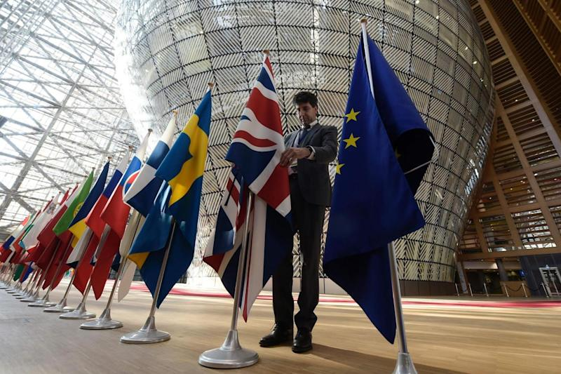 Brexit: An organiser adjusts the British national flag prior to the summit (AFP/Getty Images)