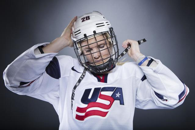 Olympic hockey player Amanda Kessel mimics her pre-game preparation during the 2013 U.S. Olympic Team Media Summit in Park City, Utah October 2, 2013. REUTERS/Lucas Jackson (UNITED STATES - Tags: SPORT OLYMPICS PORTRAIT ICE HOCKEY)