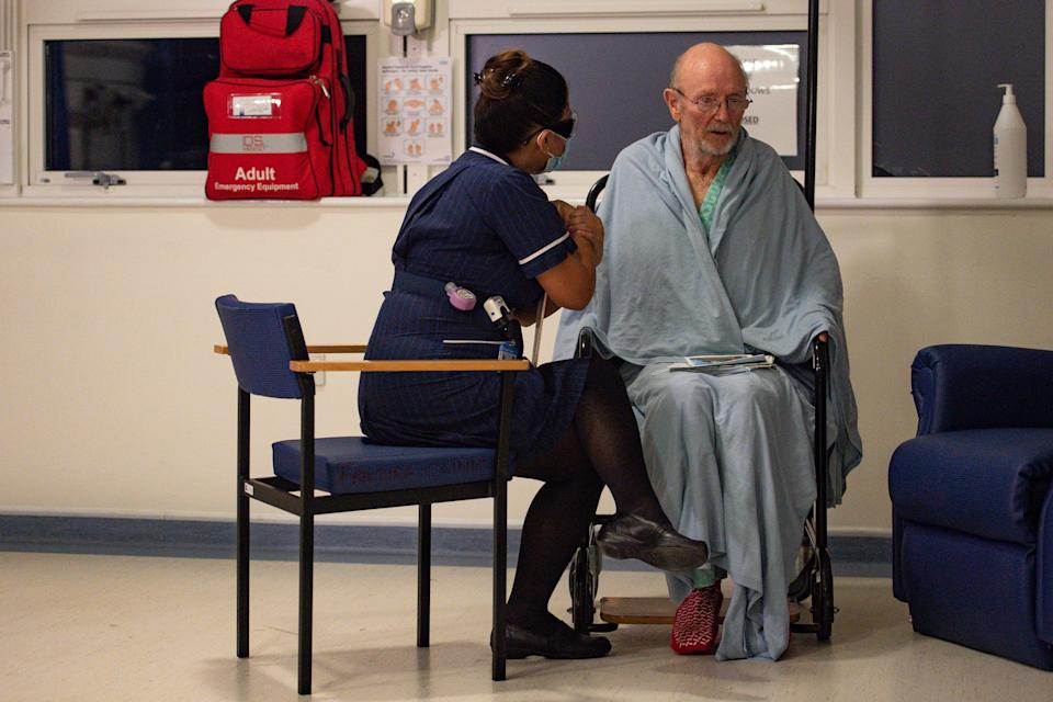 """""""Bill"""" William Shakespeare, 81, receives the Pfizer/BioNTech covid-19 vaccine at University Hospital, Coventry, at the start of the largest ever immunisation programme in the UK's history."""