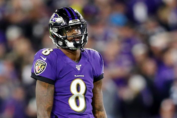 Lamar Jackson of the Baltimore Ravens reacts after throwing an incomplete pass during the first half against the Tennessee Titans in the AFC Divisional Playoff game at M&T Bank Stadium on January 11, 2020 in Baltimore, Maryland.