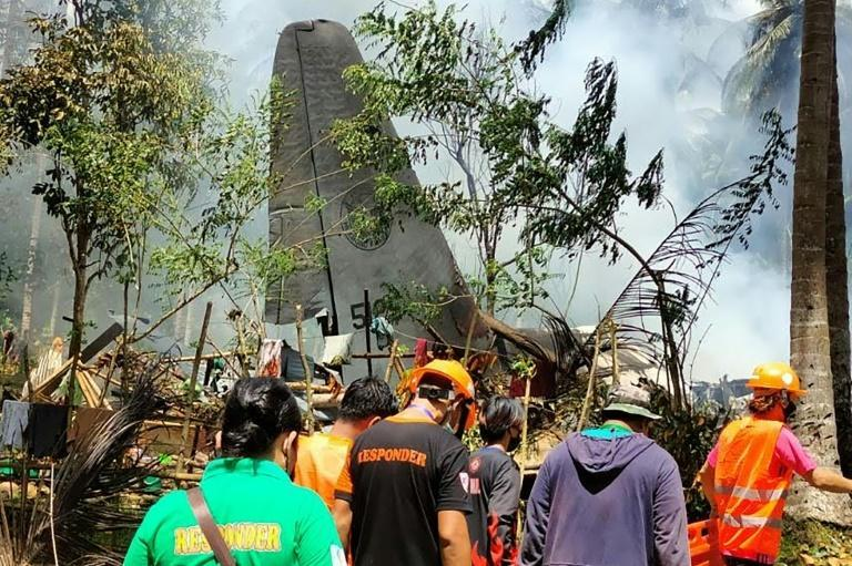 Photos of the crash site released by the Joint Task Force-Sulu showed the damaged tail and the smoking wreckage of the fuselage's back section