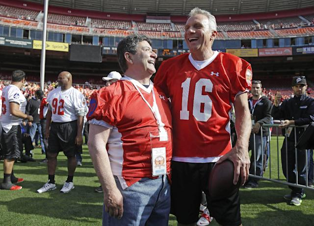 "FILE - In this July 12, 2014 file photo, San Francisco 49ers Hall of Fame quarterback Joe Montana, right, laughs with former owner Eddie DeBartolo Jr., left, before the start of the ""Legends of Candlestick"" flag football game in San Francisco. The event between former San Francisco 49er greats and a team of former NFL stars captained by Hall of Famer Dan Marino was the final football game played at Candlestick Park. Candlestick Park, known for its bone-numbing winds, the Catch and the earthquake-rocked 1989 World Series is officially closing after more than a half century of hosting sporting and cultural events. In a bow to historical symmetry, the Stick's finale will be a performance Thursday by Paul McCartney, 48 years after the Beatles' last scheduled concert lit up the venue. (AP Photo/Eric Risberg, File)"