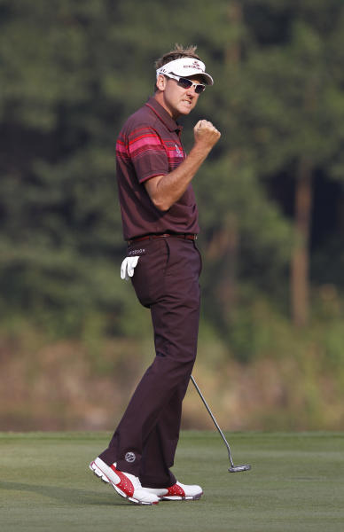 Ian Poulter from England celebrates on the 18th hole after winning the HSBC Champions golf tournament in Dongguan, southern China's Guangdong province, Sunday Nov. 4, 2012. (AP Photo/Kin Cheung)