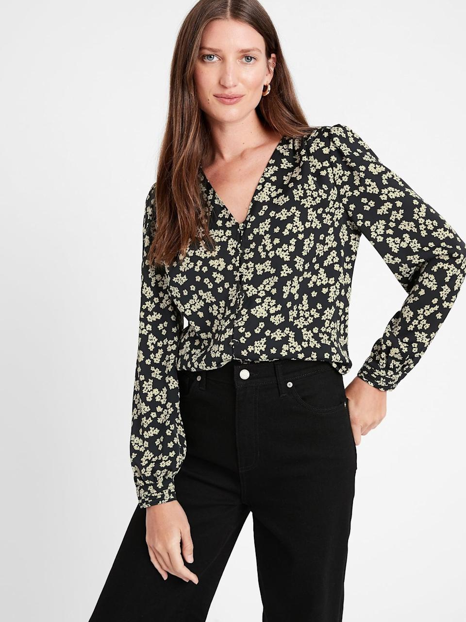 <p>This <span>Banana Republic Soft Satin V-Neck Blouse</span> ($47, originally $80) would look great with super high waisted denim!</p>