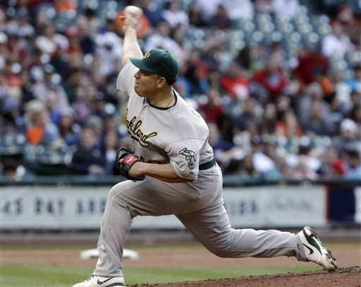 Oakland Athletics' Bartolo Colon delivers a pitch against the Houston Astros in the second inning of a baseball game Saturday, April 6, 2013, in Houston. (AP Photo/Pat Sullivan)