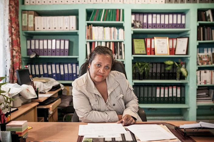 Norotiana Jeannoda poses at her desk in Antananarivo on July 22, 2014 (AFP Photo/RIJASOLO)