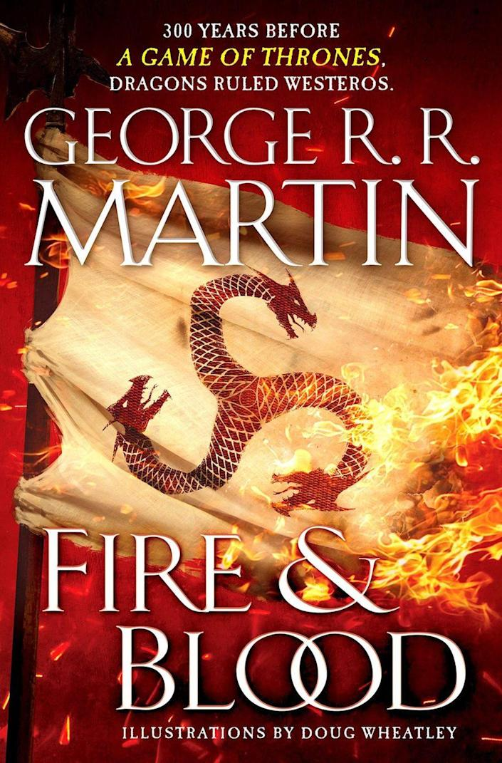A three-headed dragon on a burning flag on the cover of George R.R. Martin's Fire & Blood