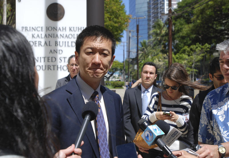Hawaii Attorney General Douglas Chin speaks outside federal court in Honolulu, Wednesday, March 29, 2017. A federal judge in Hawaii questioned government attorneys Wednesday who urged him to narrow his order blocking President Donald Trump's travel ban because suspending the nation's refugee program has no effect on the state. U.S. District Judge Derrick Watson is hearing arguments on whether to extend his temporary order until Hawaii's lawsuit works its way through the courts. Even if he does not issue a longer-lasting hold on the ban, his temporary block would stay in place until he rules otherwise. (AP Photo/Caleb Jones)