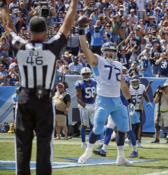 Tennessee Titans tackle David Quessenberry celebrates his second-quarter touchdown catch. (Getty Images)