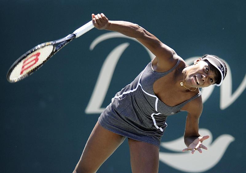 Venus Williams serves to her sister Serena Williams during the semifinals at the Family Circle Cup tennis tournament in Charleston, S.C., Saturday, April 6, 2013. Serena won 6-1, 6-2. (AP Photo/Stephen Morton)
