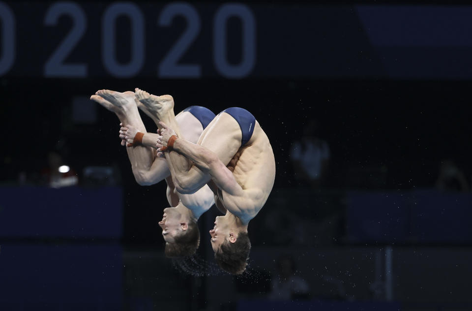 <p>TOKYO, JAPAN - JULY 26: Tom Daley and Matty Lee of Team Great Britain compete during the Men's Synchronised 10m Platform Final on day three of the Tokyo 2020 Olympic Games at Tokyo Aquatics Centre on July 26, 2021 in Tokyo, Japan. (Photo by Jean Catuffe/Getty Images)</p>