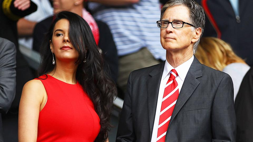 John W Henry, pictured here with wife Linda at a Liverpool game in 2011.