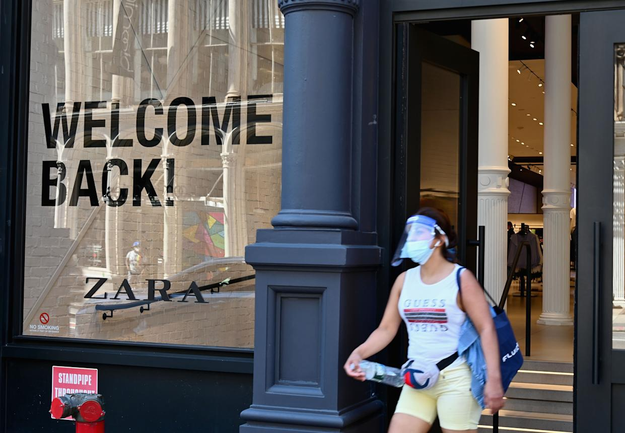 A person wearing a face mask and face shield walks out of a Zara store on Broadway in SoHo on June 24, 2020.
