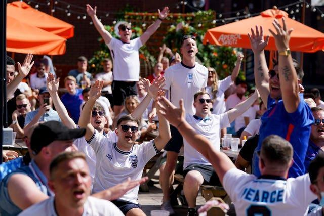 Fans celebrate victory after watching England v Croatia