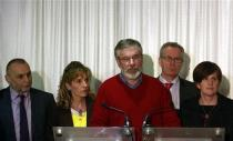 Sinn Fein President Gerry Adams (C) and party colleagues speak to the media in Belfast following the end of talks to resolve divisive issues that have hampered the Northern Ireland peace process which have broken up without agreement, December 31, 2013. REUTERS/Cathal McNaughton