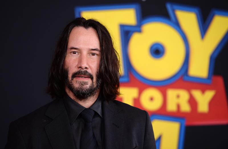 """LOS ANGELES, CALIFORNIA - JUNE 11: Keanu Reeves arrives at the premiere of Disney and Pixar's """"Toy Story 4"""" on June 11, 2019 in Los Angeles, California. (Photo by Amanda Edwards/WireImage)"""