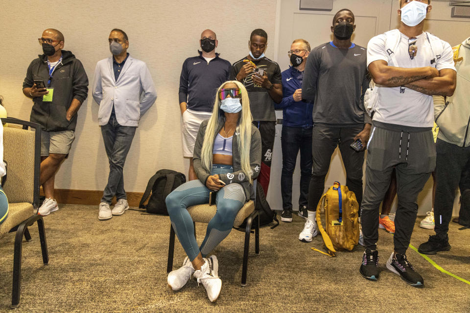 Sha'carri Richardson, seated, attends a news conference Friday, Aug. 20, 2021, a day before competing in the 100 meters at the Pre Classic track and field meet in Eugene, Ore. (AP Photo/Thomas Boyd)