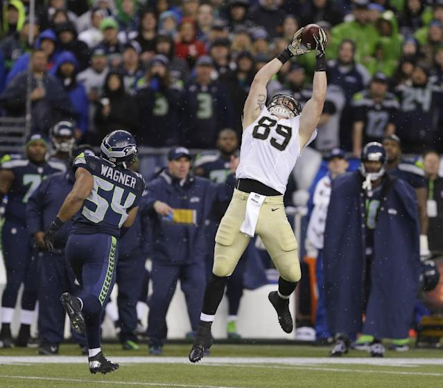 New Orleans Saints tight end Josh Hill, right, catches a pass next to Seattle Seahawks middle linebacker Bobby Wagner (54) during the second half of an NFC divisional playoff NFL football game in Seattle, Saturday, Jan. 11, 2014. (AP Photo/Ted S. Warren)