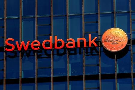 FILE PHOTO: Swedbank sign is seen on the building of the bank's Lithuanian headquarters in Vilnius, Lithuania March 30, 2019. REUTERS/Ints Kalnins/File Photo