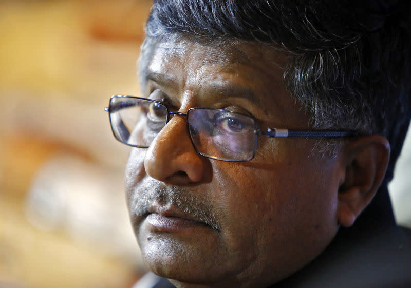 India?s Law and TM Prasad pauses during a news conference in New Delhi