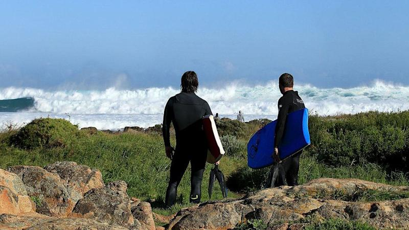 Surfers look back at the swell on Cowaramup Bay, in Gracetown. Source: File pic, Getty Images
