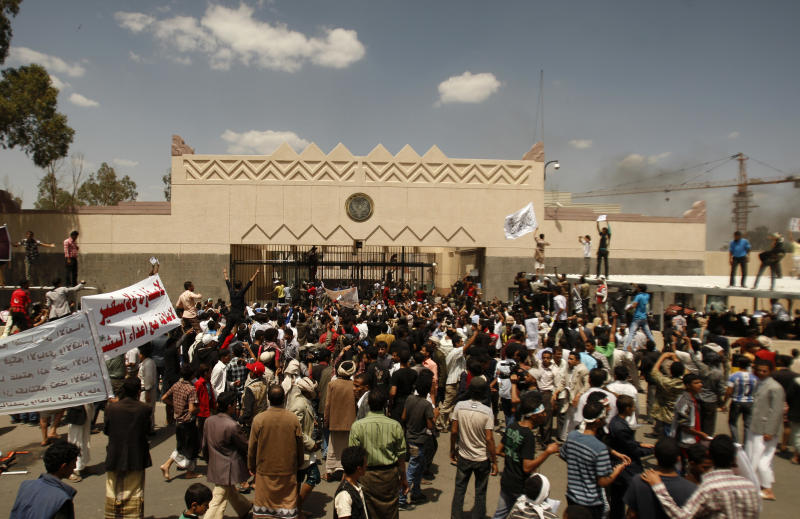 """Yemenis protest in front of the U.S. Embassy about a film ridiculing Islam's Prophet Muhammad, in Sanaa, Yemen, Thursday, Sept. 13, 2012. Dozens of protesters gather in front of the US Embassy in Sanaa to protest against the American film """"The Innocence of Muslims"""" deemed blasphemous and Islamophobic. (AP Photo/Hani Mohammed)"""