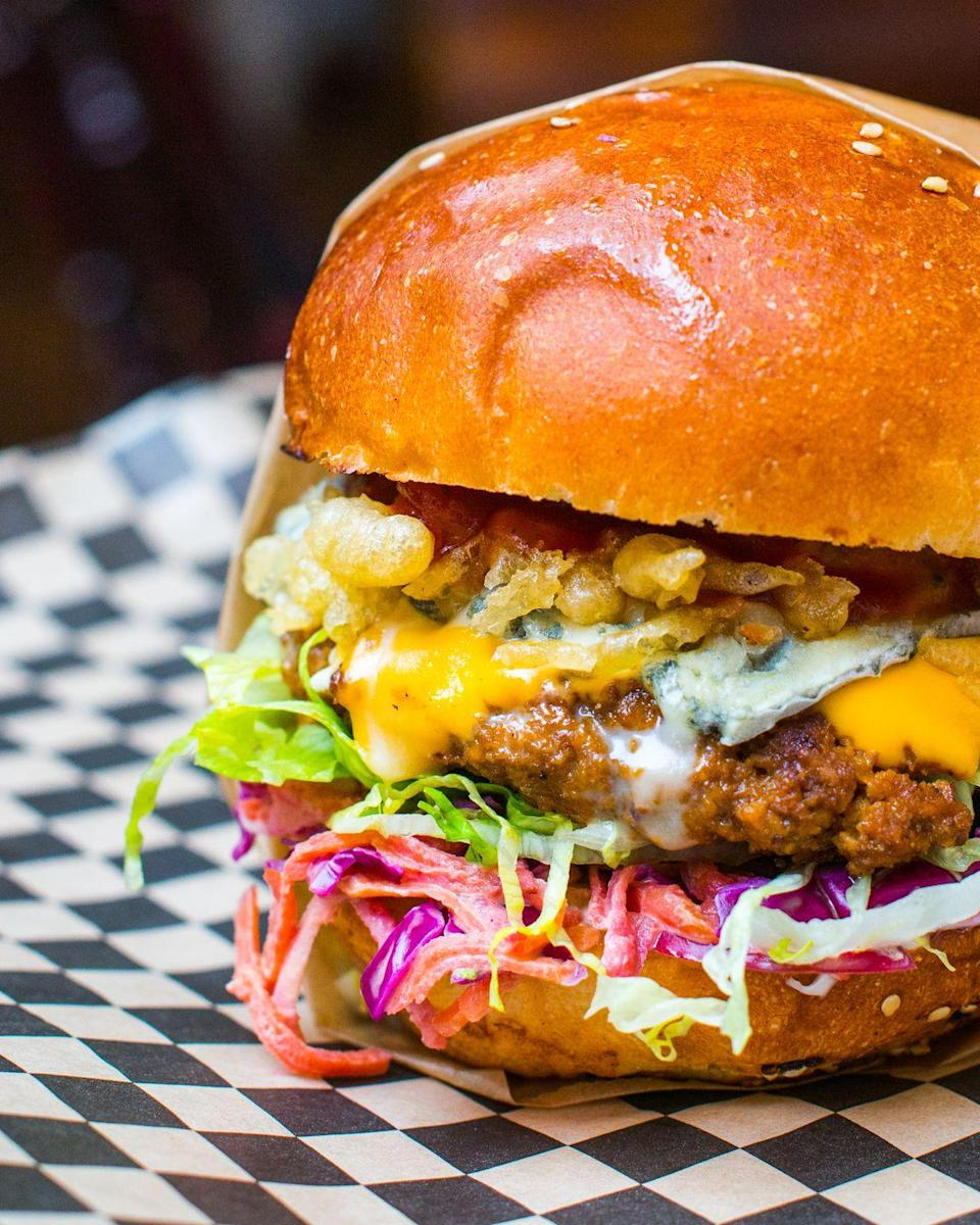"""<p>Slightly off the beaten path, to dine at The Full Nelson, you'll have to make a pilgrimage south of the river, but boy will it be worth it.</p><p>Not your usual healthy vegan fare, the Full Nelson is for junk food lovers who've given up meat and dairy but still crave their fix.</p><p>With finger-licking good (seitan) 'chicken' burgers and tater tots to boot, this place is the Five Guys of vegandom.</p><p>It's very small, so head there early and plan to have a drink at the bar until a table comes available.</p><p>Located in Deptford, you can reach it by Overground to New Cross, or DLR to Deptford Bridge. </p><p>For more info, <a href=""""https://thefullnelsondeptford.co.uk/"""" rel=""""nofollow noopener"""" target=""""_blank"""" data-ylk=""""slk:click here"""" class=""""link rapid-noclick-resp"""">click here</a>.</p>"""