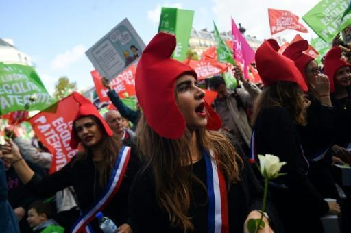 Many protesters wore the distinctive cone-shaped red Phyrgian hats that are a symbol of the French republic