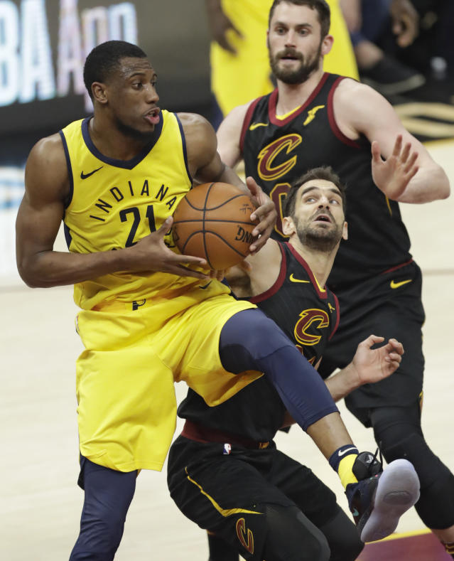Indiana Pacers' Thaddeus Young (21) grabs a rebound ahead of Cleveland Cavaliers' Jose Calderon (81), from Spain, in the second half of Game 5 of an NBA basketball first-round playoff series, Wednesday, April 25, 2018, in Cleveland. The Cavaliers won 98-95. (AP Photo/Tony Dejak)