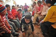 Romanian children, members of Roma community, play during class at the local kindergarten in Araci village, 200 kms north from Bucharest, in March 2012. A food coupon of about 12 euros a month ($15) is given to families living below the poverty level for each child who attends kindergarten daily -- a measure that has led to average 89 percent attendance records