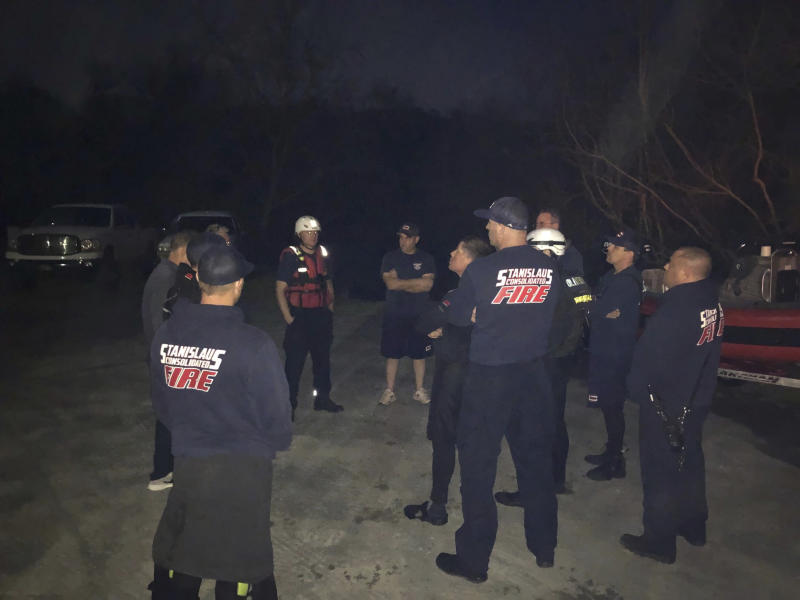 In this Sunday, March 17, 2019 photo provided by the Stanislaus Consolidated Fire Protection District Authorities fire and rescue personnel search for a 5-year-old girl who was swept away by a swollen river in Central California. The Stanislaus Sheriff's Department says the girl slipped off rocks and fell into the Stanislaus River Sunday afternoon. It says several relatives and bystanders tried to rescue her but couldn't reach her. The department says in a statement crews on boat and a helicopter searched until darkness Sunday but called off their search because of the river's dangerous conditions. (Stanislaus Consolidated Fire Protection District via AP)